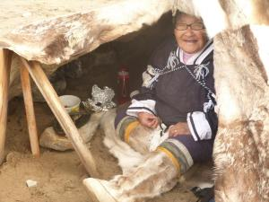 local woman Gjoa Haven, Nunuvut giving out raw narwhal samples